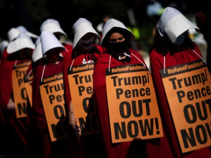WASHINGTON, DC - OCTOBER 15: Dressed as handmaids, opponents of Supreme Court nominee Judge Amy Coney Barrett demonstrate outside the Supreme Court as the Senate Judiciary Committee continues to consider Barrett's nomination on Capitol Hill on October 15, 2020 in Washington, DC. Barrett was nominated by President Donald Trump to …