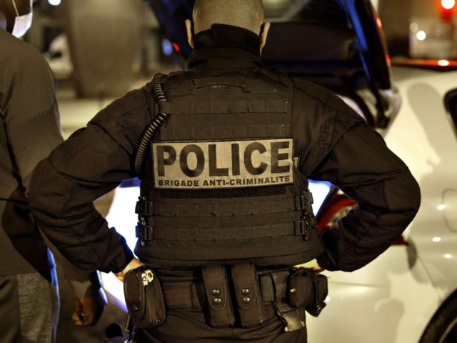 A French police officer of the anti-crime squad, Brigade Anti-Criminalite de nuit (BAC N 75) is seen during a control in Paris, on October 16, 2020. (Photo by THOMAS COEX / AFP) (Photo by THOMAS COEX/AFP via Getty Images)