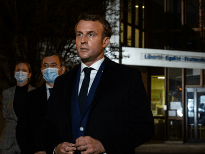 TOPSHOT - French President Emmanuel Macron (R), flanked by French Interior Minister Gerald Darmanin (2L), speaks to the press in front of a middle school in Conflans Saint-Honorine, 30kms northwest of Paris, on October 16, 2020, after a teacher was decapitated by an attacker who has been shot dead by …