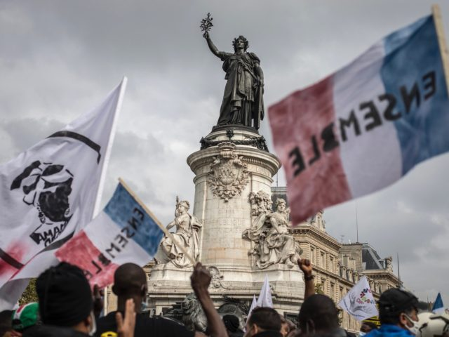 PARIS, FRANCE - OCTOBER 17: Supporters and migrants converge from all over France at the Place de la Republique for a mass protest calling for migrant's administrative rights, housing for all and the closure of administrative detention centers on October 17, 2020 in Paris, France. For several months undocumented migrants …