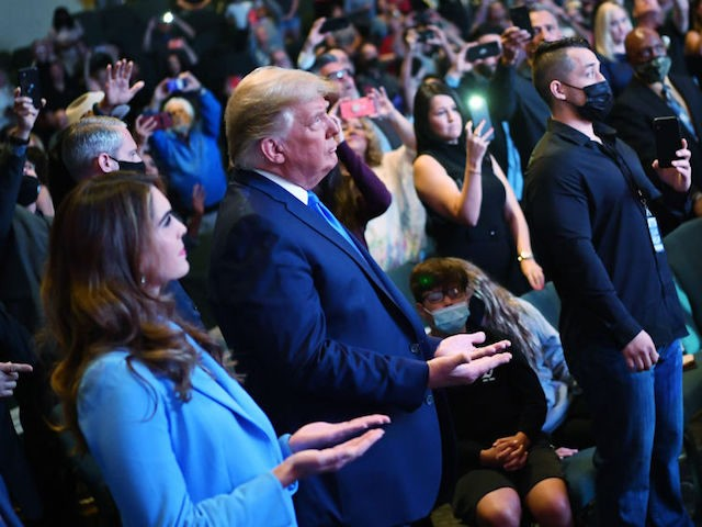 Hope Hicks (L), senior adviser to the president, attends services with U.S. President Donald Trump at the International Church of Las Vegas in Las Vegas, Nevada, on October 18, 2020. - President Donald Trump and rival Joe Biden hit the ground Sunday in the swing states that will decide the …