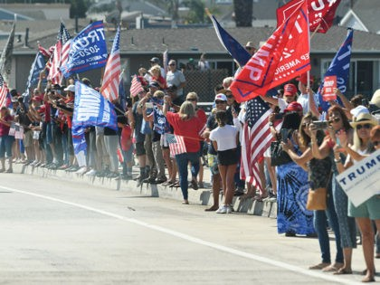 Supporters cheer as the motorcade of US President Donald Trump passes by near John Wayne Airport in Santa Ana, California on October 18, 2020. - Trump is heading to Newport Beach, California a fundraiser. (Photo by MANDEL NGAN / AFP) (Photo by MANDEL NGAN/AFP via Getty Images)