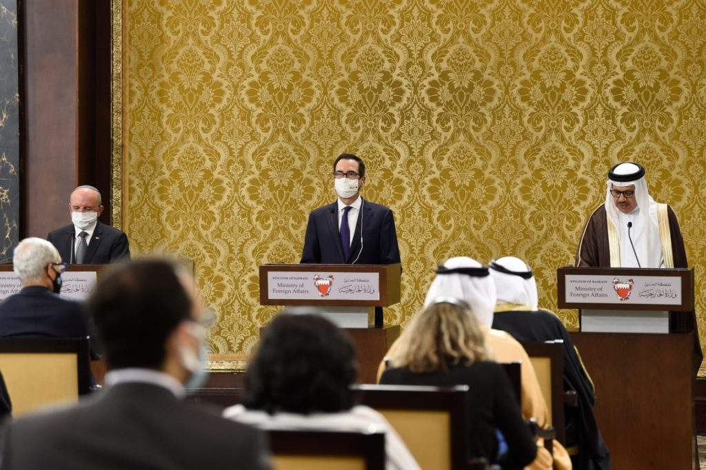 Bahraini Foreign Minister Abdullatif bin Rashid Al-Zayani (R) speaks during a joint press conference with head of the Israeli delegation National Security Advisor Meir Ben Shabbat(L) and US Treasury Secretary Steve Mnuchin, following an agreement signing ceremony in Bahrain's capital Manama on October 18, 2020. - Israel and Bahrain cemented a deal officially establishing relations and signed several memorandums of understanding, further opening up the wealthy Gulf region to the Jewish state. (Photo by Mazen Mahdi / AFP) (Photo by MAZEN MAHDI/AFP via Getty Images)