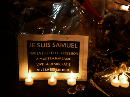 TOPSHOT - This picture taken on October 20, 2020, during the 'Marche Blanche' in Conflans-Sainte-Honorine, northwest of Paris, shows a sign reading 'I am Samuel. Long live freedom of expression' in solidarity after a teacher was beheaded for showing pupils cartoons of the Prophet Mohammed. His murder in a Paris …