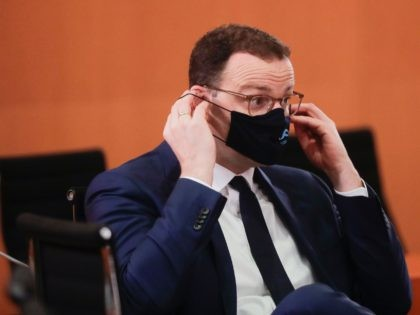 German Health Minister Jens Spahn adjusts his face mask as he attends the weekly cabinet meeting of the German government at the Chancellery in Berlin on October 21, 2020. (Photo by Markus Schreiber / POOL / AFP) (Photo by MARKUS SCHREIBER/POOL/AFP via Getty Images)