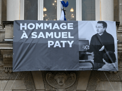 TOPSHOT - A portrait of French teacher Samuel Paty is displayed on the facade of the Opera Comedie in Montpellier on October 21, 2020, during a national homage to the teacher who was beheaded for showing cartoons of the Prophet Mohamed in his civics class. - France pays tribute on …
