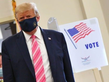 US President Donald Trump leaves the polling station after casting his ballot at the Palm Beach County Public Library, during early voting for the November 3 election, in West Palm Beach, Florida, on October 24, 2020.