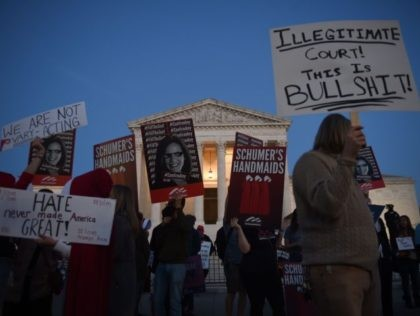 Supporters of Judge Amy Coney Barrett and pro-choice supporters gather outside of the US Supreme Court as the Senate is expected to confirm President Trump's Supreme Court nominee on Capitol Hill on October 26, 2020 in Washington, DC. (Photo by Olivier DOULIERY / AFP) (Photo by OLIVIER DOULIERY/AFP via Getty …