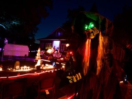 Halloween decorations are displayed in front of a home on October 30, 2020 in Sierra Madre, California. - The neighborhood is famous for huge crowds coming out to view the displays while trick or treating, though this year the second largest commercial holiday in the United States will be celebrated …