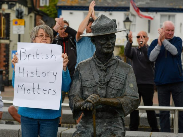 POOLE, ENGLAND - JUNE 11: Locals show their support for the Lord Baden-Powell statue on June 11, 2020 in Poole, United Kingdom. The statue of Robert Baden-Powell on Poole Quay is to be placed into safe storage after campaigners have accused him of racism, homophobia and support for Adolf Hitler. …