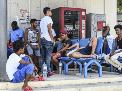 "LAMPEDUSA, ITALY - AUGUST 04: Migrants in the Lampedusa hotspot, reportedly collapsing, waiting to be transferred to the quarantine ship ""Gnv Azzurra"" on August 04, 2020 in Lampedusa, Italy. The Italian island has reportedly run out of room to quarantine migrants, as is required as part of Italy's anti-coronavirus measures. …"