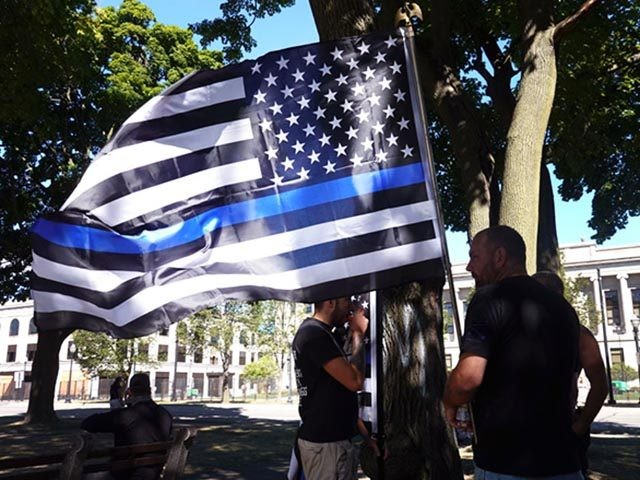 KENOSHA, WISCONSIN - AUGUST 30: Demonstrators hold a Back the Blue Rally in front of the Kenosha County Courthouse on August 30, 2020 in Kenosha, Wisconsin. The city is recovering from several days of unrest and demonstrations after Jacob Blake was shot several times at close range in the back …