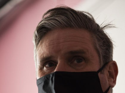 LONDON, ENGLAND - OCTOBER 06: Labour leader Keir Starmer wears a face mask while speaking to staff during a visit to 'The Project Surgery' on October 06, 2020 in London, England. Mr Starmer visited 'The Project Surgery' in Newham to speak to staff about their experiences during the Covid-19 pandemic. …