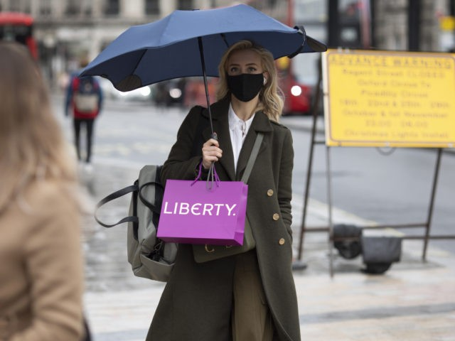 LONDON, ENGLAND - OCTOBER 13: Shoppers and commuters around Oxford Street on October 13, 2020 in London, England. London Mayor Sadiq Khan said today that the city would move into Tier 2 of the government's new covid-19 risk classification once it hits 100 new daily cases per 100,000 people, which …