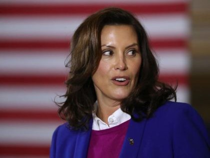 SOUTHFIELD, MICHIGAN - OCTOBER 16: Gov. Gretchen Whitmer introduces Democratic presidential nominee Joe Biden delivers remarks about health care at Beech Woods Recreation Center October 16, 2020 in Southfield,m Michigan. With 18 days until the election, Biden is campaigning in Michigan, a state President Donald Trump won in 2016 by …