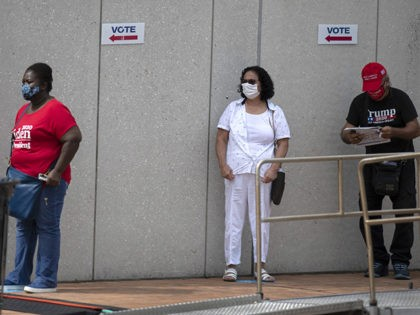 WESTCHESTER, FLORIDA - OCTOBER 19: Voters wait in line, socially distanced from each other, to cast their early ballots at the Westchester Regional Library polling station on October 19, 2020 in Westchester, Florida. The early voting ends on Nov. 1. Voters are casting their ballots for presidential candidates President Donald …