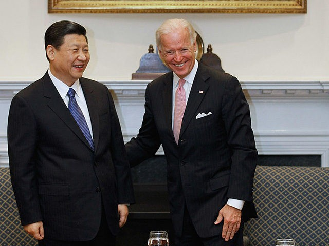 WASHINGTON, DC - FEBRUARY 14: (AFP OUT) U.S. Vice President Joe Biden (R) and Chinese Vice President Xi Jinping laugh during an expanded bilateral meeting with other U.S. and Chinese officials in the Roosevelt Room at the White House February 14, 2012 in Washington, DC. While in Washington, Vice President …