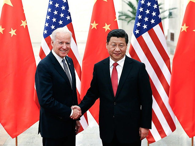Chinese President Xi Jinping (R) shakes hands with US Vice President Joe Biden (L) inside the Great Hall of the People in Beijing on December 4, 2013. Biden arrived in Beijing to raise concerns over a Chinese air zone ramping up regional tensions, looking to bolster ties while also underscoring …
