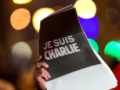 PARIS, FRANCE - JANUARY 07: Signs saying 'Je suis Charlie' are held up as crowds gather at 'Place de la Republique' for a vigil following the terrorist attack earlier today on January 7, 2015 in Paris, France. Twelve people were killed, including two police officers, as two gunmen opened fire …