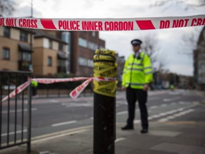 SOUTHWARK, ENGLAND - MARCH 23: Police officers cordon off an area of the site of an unexploded World War Two bomb on March 23, 2015 in Southwark, England. Over 1,000 homes in the south London borough have been evacuated after the 1000lb bomb was found on a building site in …