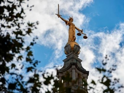 "The ""Lady of Justice"", a 12 foot high, gold leaf statue is pictured on top of the dome of the Central Criminal Court, commonly referred to as The Old Bailey in central London on August 21, 2016. - Over the centuries the building has been periodically remodelled and rebuilt. The …"