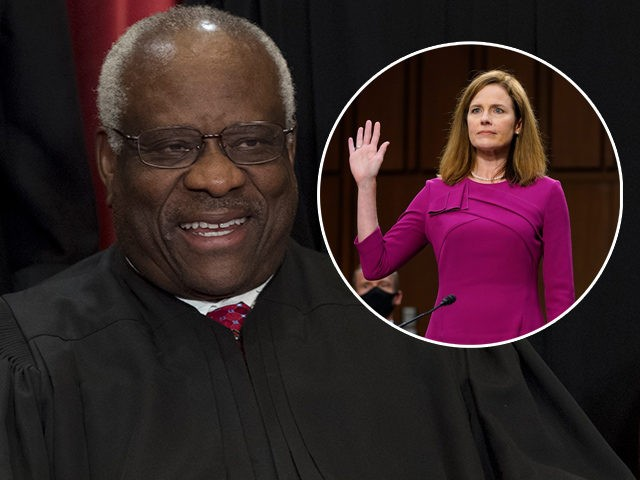 (INSET: Amy Coney Barrett) US Supreme Court Associate Justice Clarence Thomas sits for an official photo with other members of the US Supreme Court in the Supreme Court in Washington, DC, June 1, 2017. (Photo by SAUL LOEB / AFP) (Photo by SAUL LOEB/AFP via Getty Images)