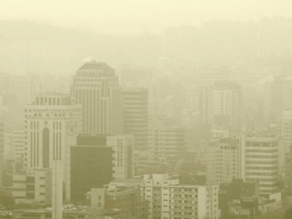 SEOUL, REPUBLIC OF KOREA: Skyscrapers in downtown Seoul on 13 March 2006 are shrouded by yellow dust storms blowing in from China's Gobi desert. UN Secretary General Kofi Annan said in a message 05 June 2006 for World Environment Day that desertification is exacerbating extreme poverty and sparking conflict over …