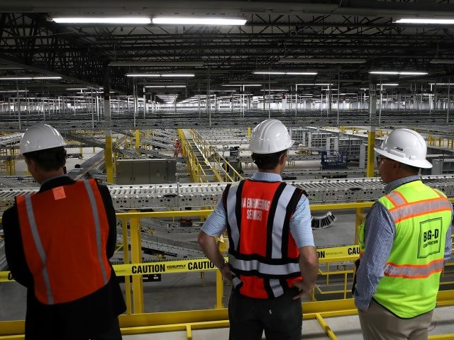 SACRAMENTO, CA - AUGUST 10: Workers view a conveyor belt system that is under construction at a new Amazon fulfillment center on August 10, 2017 in Sacramento, California. Amazon is preparing to open a new 855,000-square-foot warehouse, the tenth in California, by early October and is expected to hire nearly …
