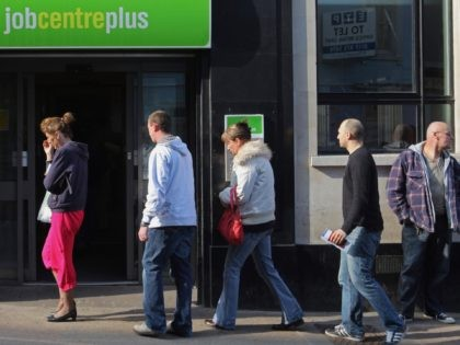 BRISTOL, UNITED KINGDOM - MARCH 18: People queue outside a Job Centre on March 18, 2009 in Bristol, England. Official figures published today show that UK unemployment has risen above two million for the first time since 1997 - and according to the TUC, there are now 10 jobseekers for …
