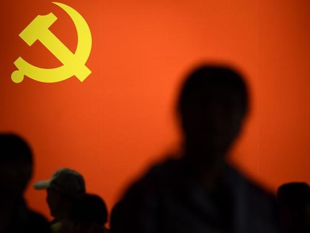 TOPSHOT - This picture taken on October 10, 2017 shows a party flag of the Chinese Communist Party displayed at an exhibition showcasing China's progress in the past five years at the Beijing Exhibition Center.