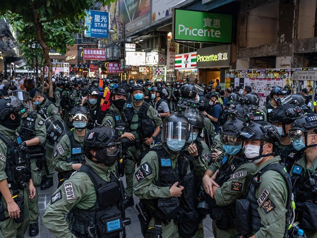HONG KONG, CHINA - OCTOBER 01: Riot police secure an area on national day in a shopping area on October 1, 2020 in Hong Kong, China. Hong Kong police arrested over 60 for unauthorised assembly after conducting stop and search operation as 6000 officers were deployed in force to prevent …