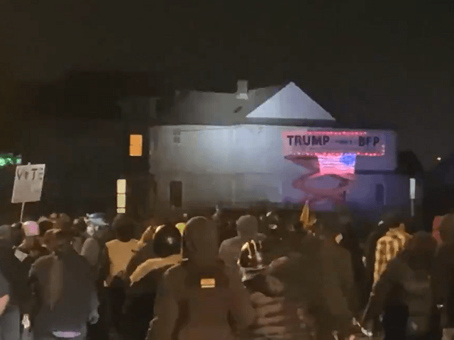 Antifa protesters vandalize a Vancouver home displaying a Trump sign. (Twitter Video Screenshot)