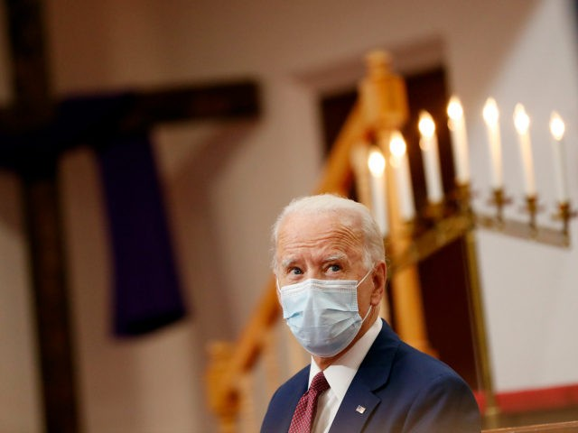 Democratic presidential candidate, former Vice President Joe Biden listens as clergy members and community activists speak during a visit to Bethel AME Church in Wilmington, Del., Monday, June 1, 2020. (AP Photo/Andrew Harnik)