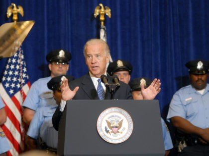 U.S. Vice President Joe Biden speaks job legislation at the Alexandria Police Department, with Chief of Police Earl Cook (L) behind him, September 29, 2011 in Alexandria, Virginia. Biden spoke at the police department to highlight the American Jobs Act, a $5 billion piece of legislation that enables the hiring …