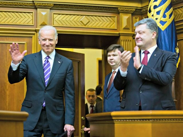 Ukrainian President Petro Poroshenko, right, applauds to U.S. Vice President Joe Biden, left, after he addressed the Ukraine Parliament in Kiev, Ukraine, Tuesday, Dec. 8, 2015. Biden addressed the Ukrainian parliament on Tuesday, criticizing Russia and saying that the US and all of Europe stood with Ukraine. (AP Photo/Mikhail Palinchak, …