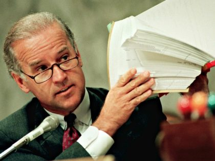 Sen. Joseph Biden, D-Del., holds up copies of a list of FBI files during a hearing of the Senate Judiciary Committee on Capitol Hill Friday June 28, 1996 to discuss White House access to FBI background files. On Friday, Anthony Marceca, the White House aide who improperly gathered FBI files …