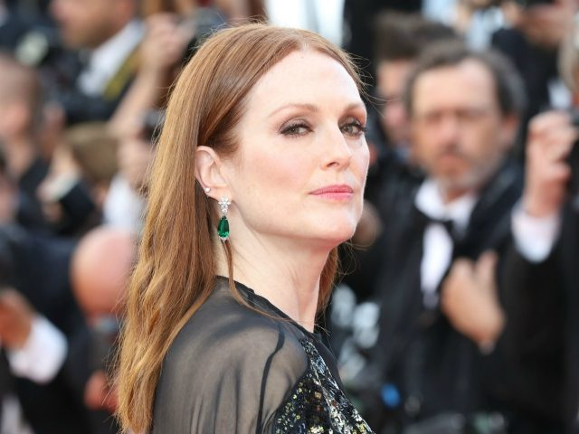 US actress Julianne Moore poses on May 11, 2016 as she arrives for the opening ceremony of the 69th Cannes Film Festival in Cannes, southern France. / AFP / Valery HACHE (Photo credit should read VALERY HACHE/AFP via Getty Images)