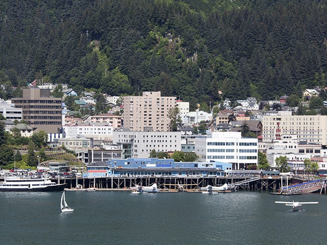 The view of water transportation and Juneau downtown skyline (Alaska).