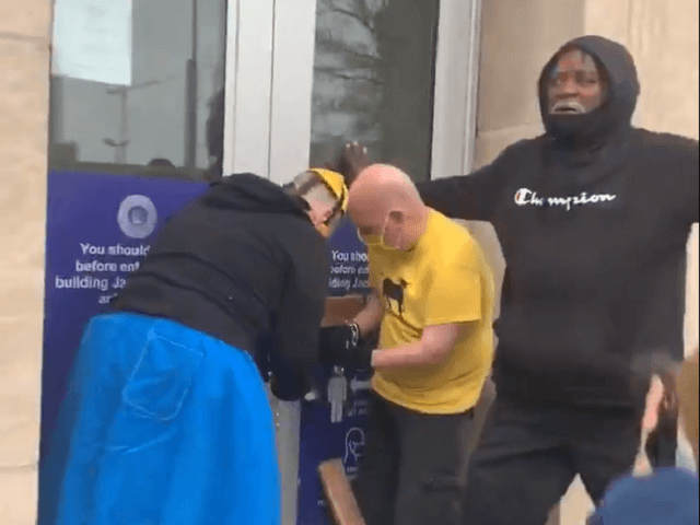 Members of KC Tenants chain the doors of the Jackson County, MO, courthouse closed during an anti-eviction protest. (Video Screenshot/KC Tenants)
