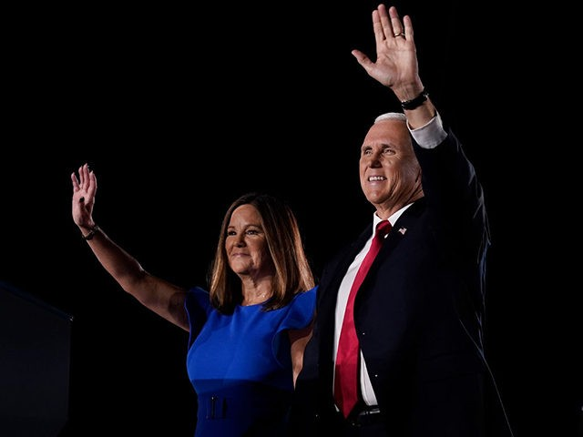 BALTIMORE, MARYLAND - AUGUST 26: Mike Pence stands with his wife Karen Pence before accepting the vice presidential nomination during the Republican National Convention from Fort McHenry National Monument on August 26, 2020 in Baltimore, Maryland. The convention is being held virtually due to the coronavirus pandemic but includes speeches …
