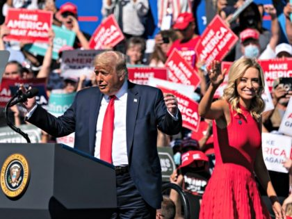 President Donald Trump gestures towards White House press secretary Kayleigh McEnany as he speaks at a campaign rally at Prescott Regional Airport, Monday, Oct. 19, 2020, in Prescott, Ariz. (AP Photo/Alex Brandon)