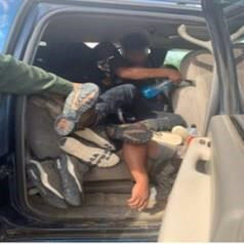 Laredo Sector Border Patrol agents find migrants packed like wood in the back seat of smuggling vehicle. (U.S. Border Patrol/Laredo Sector)