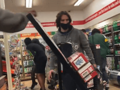 "Dozens of ""peaceful protesters"" loot a Wisconsin convenience store. (Twitter Video Screenshot/Julio Rosas)"