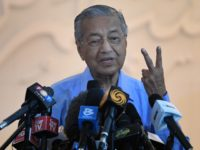 Malaysia's interim Prime Minister Mahathir Mohamad gestures during a press conference in Kuala Lumpur on March 1, 2020, after Muhyiddin Yassin was appointed as Malaysia's next prime minister by the king. - Malaysia's political crisis deepened after 94-year-old Mahathir Mohamad rejected a decision by the king to pick his rival …