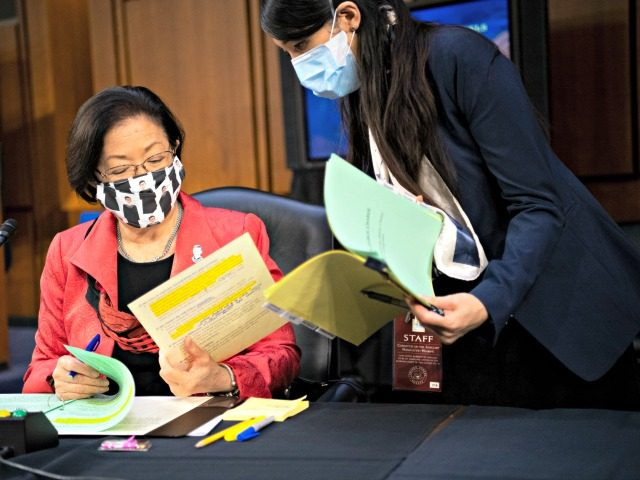 WASHINGTON, DC - OCTOBER 14: U.S. Sen. Mazie Hirono (D-HI) prepares her remarks with an aide during a break after Supreme Court nominee Judge Amy Coney Barrett testified before the Senate Judiciary Committee on the third day of her Supreme Court confirmation hearing on Capitol Hill on October 14, 2020 …