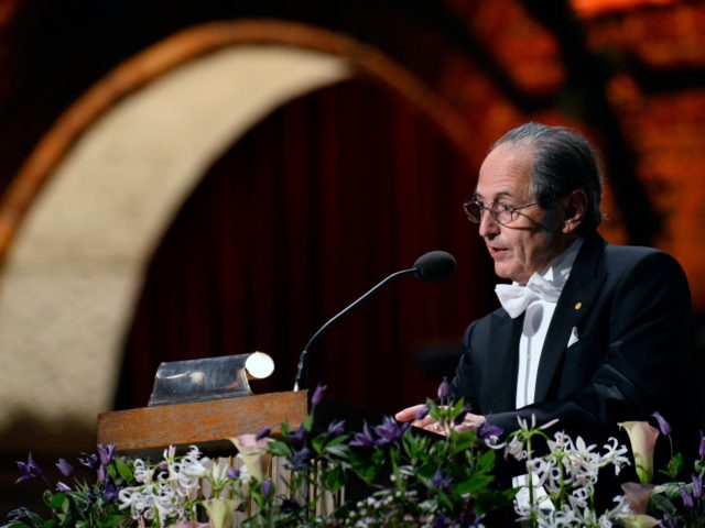 The Nobel Prize winner in Chemistry 2013, Michael Levitt, addresses the traditional Nobel Prize banquet at the Stockholm City Hall on December 10, 2013 following the Nobel Prize award ceremonies for Medicine, Physics, Chemistry, Literature and Economic Sciences. AFP PHOTO / JONATHAN NACKSTRAND (Photo credit should read JONATHAN NACKSTRAND/AFP via …