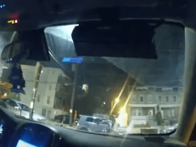 Police body-cam video shows the moment of impact as Karon Hylton is struck by a civilian SUV. (Video Screenshot/DC Police)