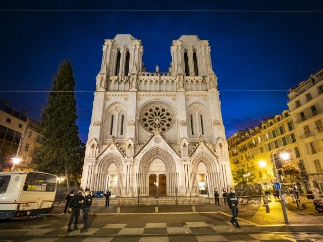 NICE, FRANCE - OCTOBER 29: Police patrol at night in front of basilica on October 29, 2020 in Nice, France. A man armed with a knife fatally attacked three people in the church, located in the heart of the city. (Photo by Arnold Jerocki/Getty Images)