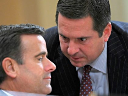 Ranking member Rep. Devin Nunes (R-CA) speaks with Rep. John Ratcliffe (R-TX) during the House Intelligence Committee hearing, into President Donald Trump's alleged efforts to tie US aid for Ukraine to investigations of his political opponents, on Capitol Hill in Washington, DC on November 19, 2019. - The US ambassador …