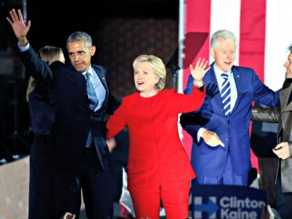 US Democratic presidential nominee Hillary Clinton (C) stands on stage with US President Barack Obama (L), former US president Bill Clinton (2nd-R) and singer Jon Bon Jovi (R) during a rally on the final night of the 2016 US presidential campaign at Independence Mall in Philadelphia, Pennsylvania, November 07, 2016 …